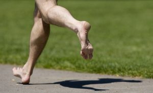 Ryan Whitaker runs barefoot at Esther Short Park, Thursday, May 12, 2011. (Steven Lane/The Columbian)